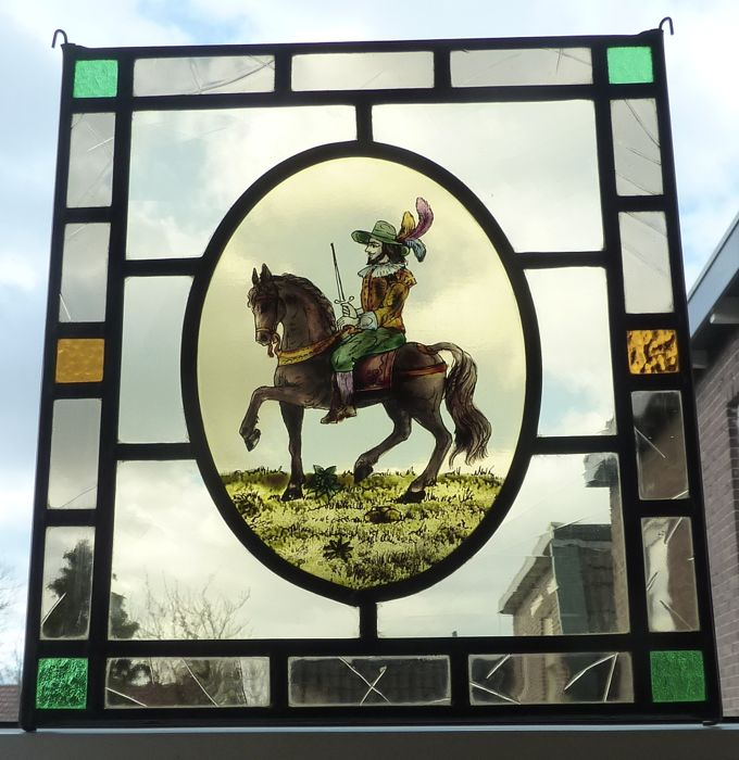 Beautiful stained glass sun catcher with an image of a musketeer horseman