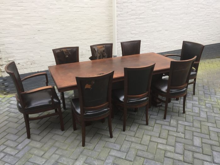 Oak conference table with set of 8 chairs, ca. 1900