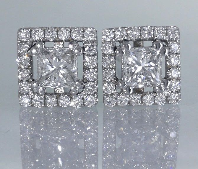 Stud earrings set with 2 princess cut diamonds, 0.60 ct, and 40 brilliant cut diamonds, 1.00 ct in total