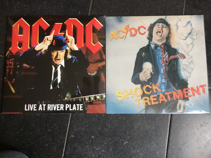 AC/DC - 2 albums 1 with 3 records  live at river plate red vinyl - shock treatment 1 record  white vinyl