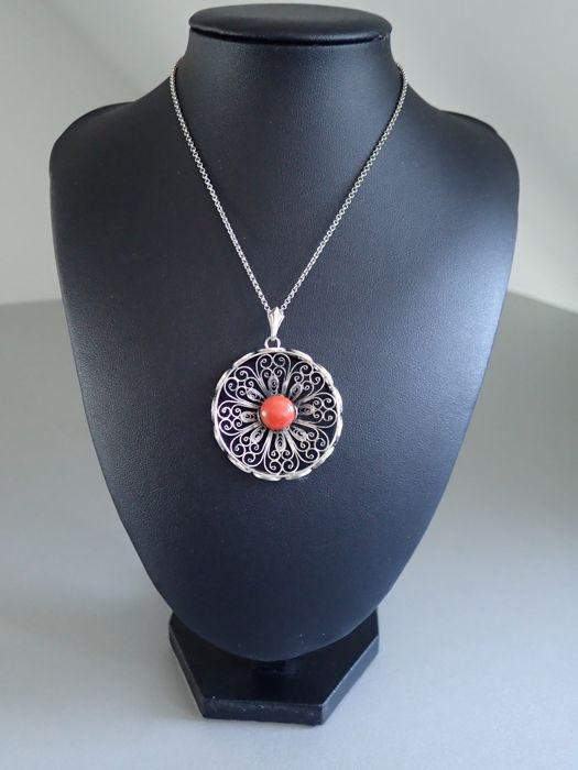 Antique silver filigree pendant with raised edge set with a pink antique silver filigree pendant with raised edge set with a pinkorange coral on aloadofball Image collections