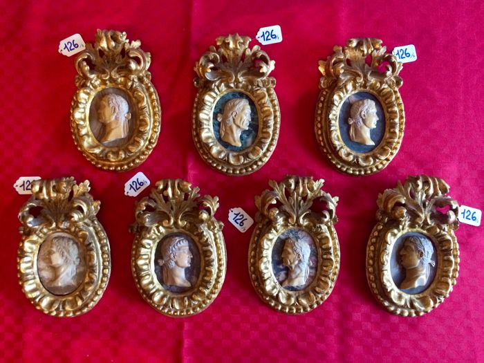 Collection of seven marble and resin bas-reliefs depicting Roman emperors, with oval gilt wood frames, Italy, 18th century