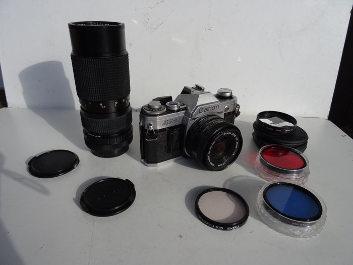 Camera Canon AE1 + lens Canon 1.8/50mm + zoom lens Rexatar 4.5/80-205 mm + 4 filters