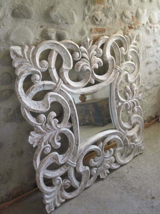 Wall mirror with a carved wood frame