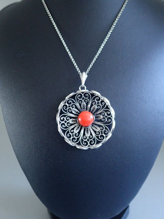 Antique silver filigree pendant with raised edge set with a pink antique silver filigree pendant with raised edge set with a pinkorange coral on an antique silver jasseron necklace aloadofball Image collections