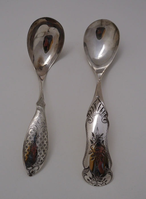 Two antique Dutch silver sauce ladles, one made by Fa J.M. van Kempen, Voorschoten, 1876, the other has an unknown maker made in 1879