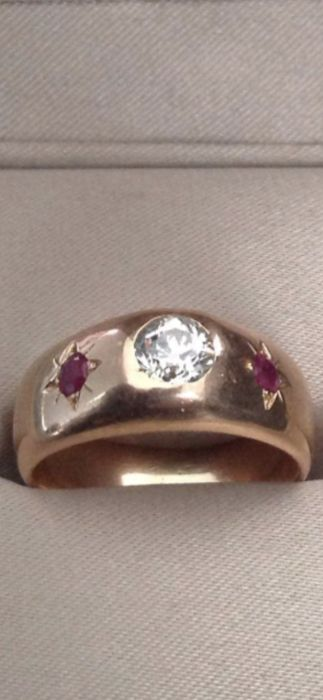 Bangle in 18 kt rose gold 9.5 g size 54 decorated with a diamond of approx. 0.50 ct and two small rubies