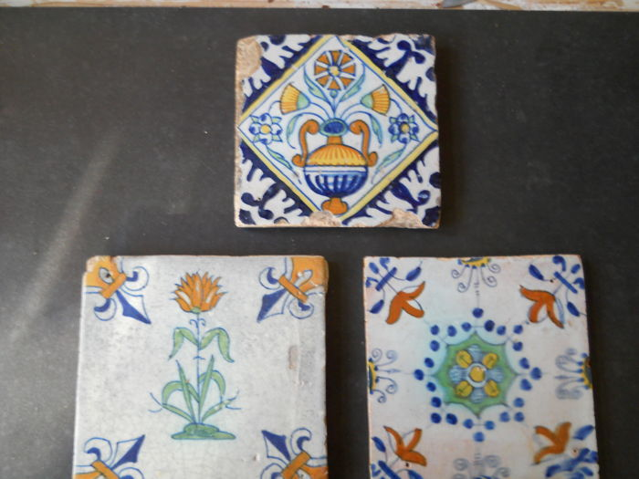 Three early 17th century tiles, one flower tile, one Haarlem star tile, one square tile, from Rotterdam, small format.
