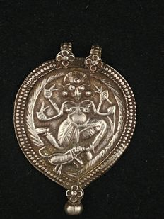 Antique silver pendant with depiction of Durga - India, mid 20th century