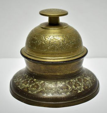 Hand chased brass elephant claw bell with stand, India, late 19th - early 20th Century