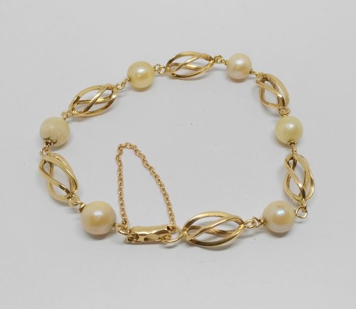 bracelet of 18 kt yellow gold - cultured pearls - length 20.5 cm