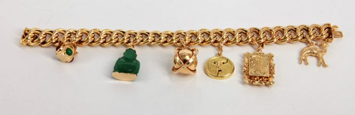Charms bracelet in 18 kt gold - Length 20 cm