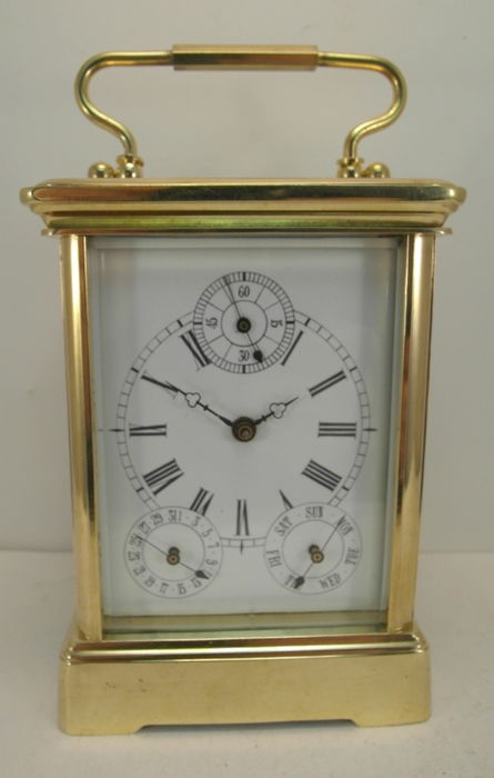 Travel clock with day and date display and second hand - late previous century