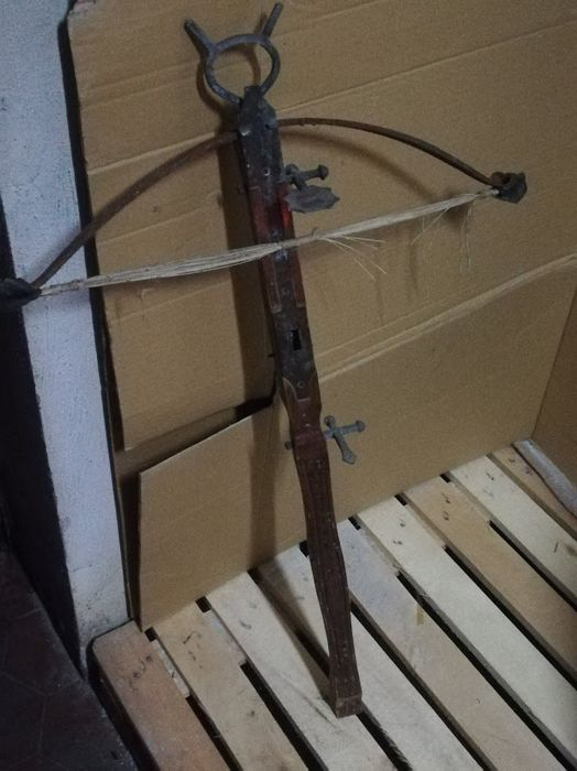 Antique wood and iron crossbow