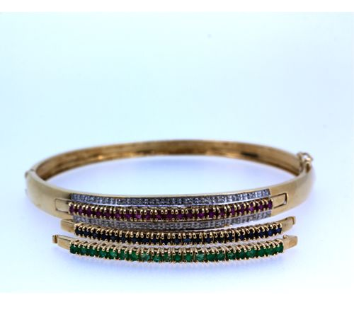 Detachable bracelet in gold with fine coloured stones
