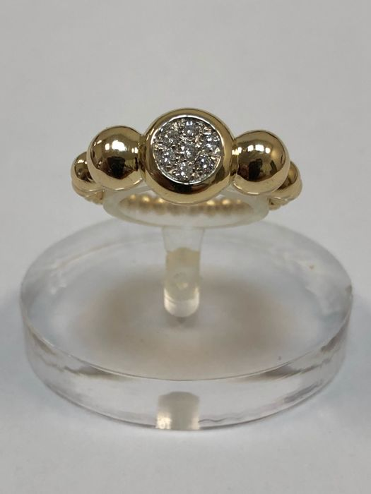 18 ct yellow gold ring, weight:  5.20 g with diamonds for 0.09 ct colour: G, clarity: VS - Size: 6 (US)