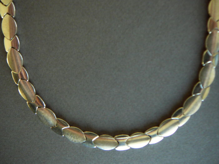 Sterling silver necklace 8 mm wide with rhodium layer.