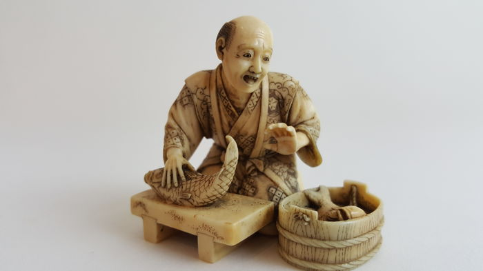 Ivory Carving of Fish seller - Japan - ca. 1900 (Meiji period)