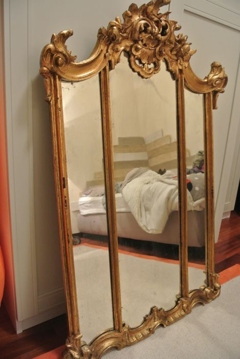 Gilt wall mirror, from the 20th century, in eclectic style