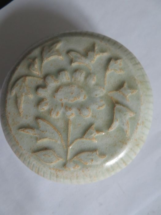 A  Chinese Qingbai glazed celadon cosmetic/medicine box with moulded flower decoration  - 102 X 45 mm