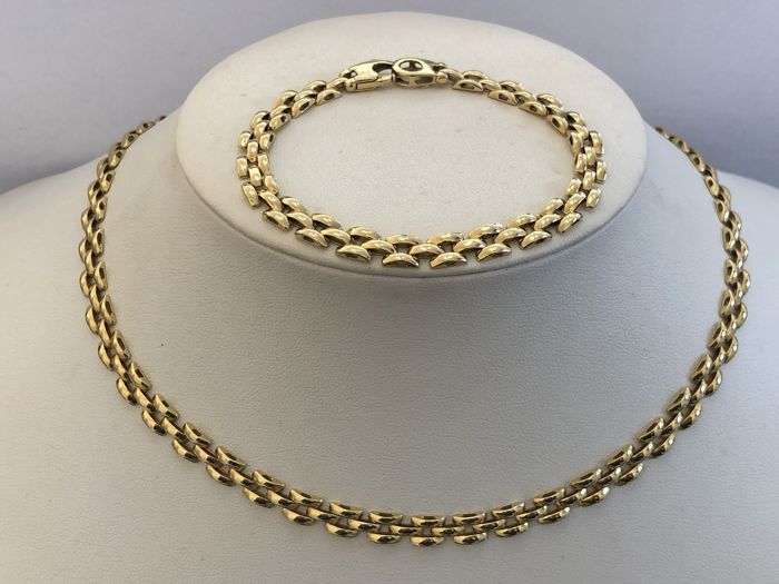 Matching necklace and bracelet in 18 kt (750) yellow gold