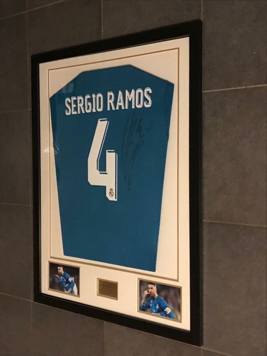 Sergio Ramos signed framed Real Madrid alternative 2017-2018 shirt with photos of the moment of signing and COA