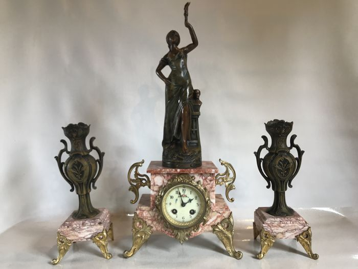 "Mantel shelf center signed ""Guillemin"" - The mechanism is signed ""Société Clusienne S. C.A. P.H Cluses"" - Pink marble - Enamel - Patinated bronze spelter - Early 20th century"