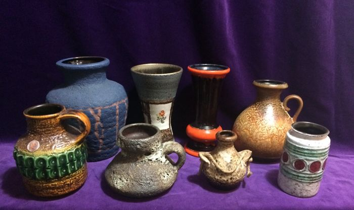 Collection with eight Fat Lava vases
