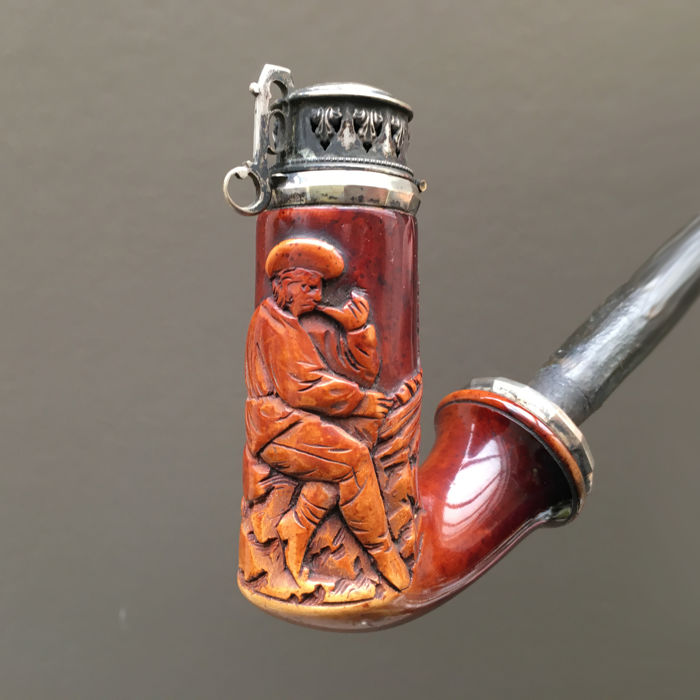 Well colored meerschaum pipe depicting a pipe smoker - Germany, ca. 1840