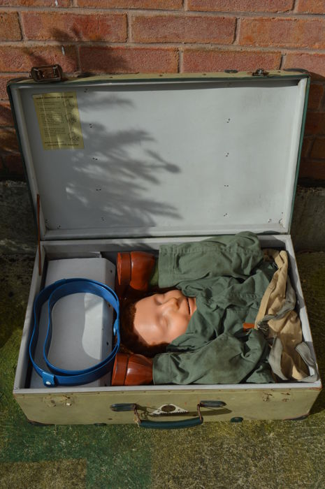 A rare life size Resusci Andy CPR mannequin contained in a large suitcase by Åsmund S. Lærdal