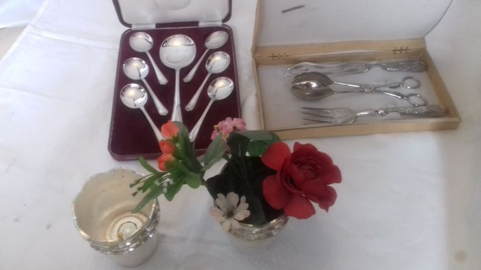 One seven spoon set. One knife fork and tonques cake serving set and six rose --flower holders table centres.