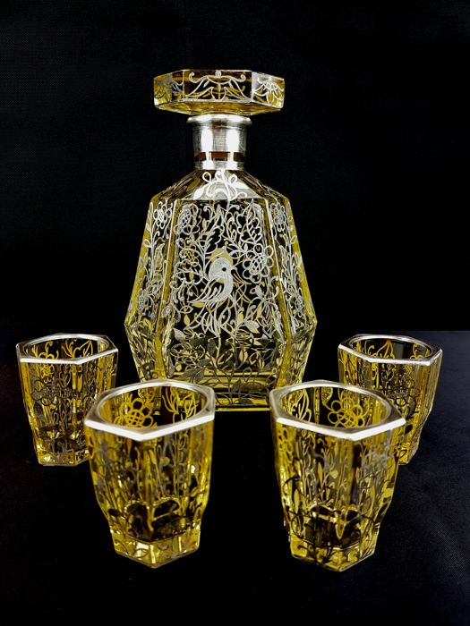 Set of 5 pieces, decanter and liquor glasses in amber coloured crystal with silver decorations