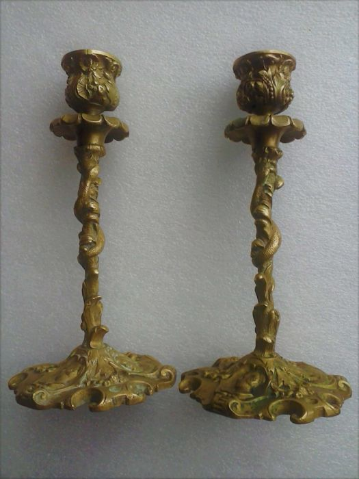 Pair of candlesticks in bronze with coiled snake decor, gothic character head, fruits and foliage - late 19th
