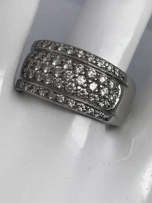 Coupling ring made of 14 kt/585 white gold with diamonds 28 x 0.05 ct set in a row in the middle & 22 x 0.01 ct each on top and bottom, creating a light 3-row look