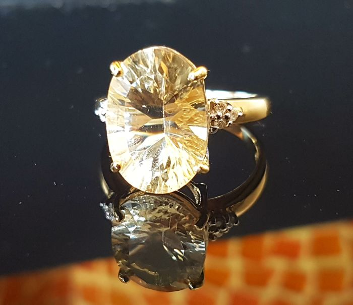 High-carat lemon citrine gold ring with diamonds