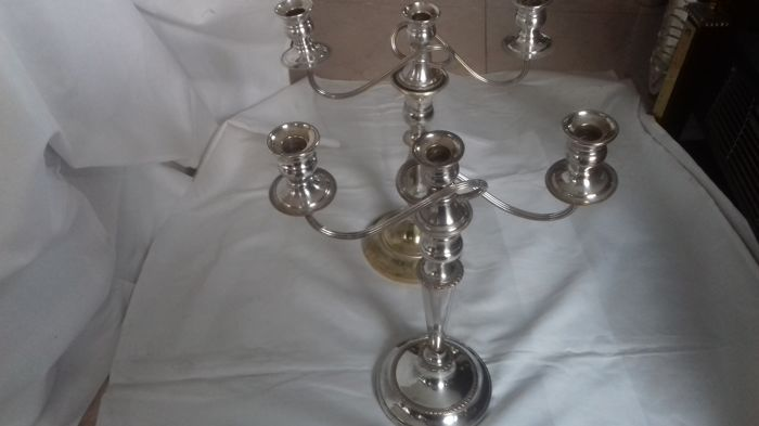 These are two church candelabras silver plated.