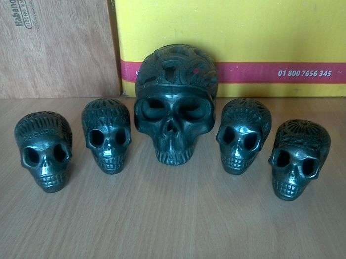 Five black terracotta skulls from Oaxaca, Mexico - recent