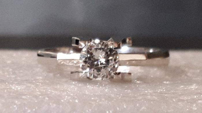 Exclusive solitaire ring, 0.65 ct diamond In 18 kt white gold