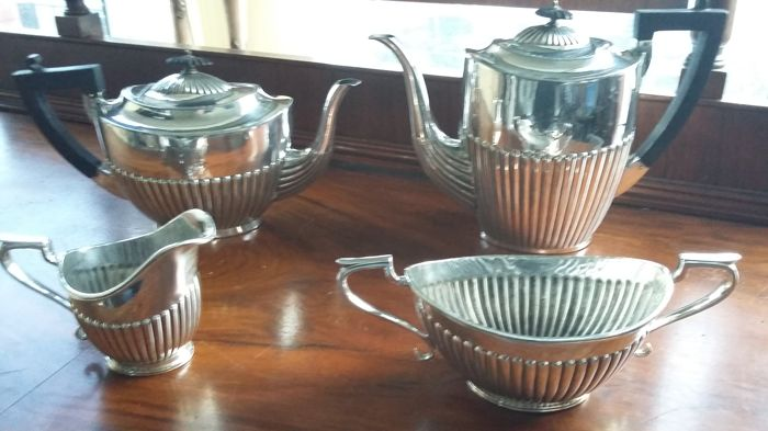 G.T (G Thomson [G] ) 19th c./1st half coffee pot & tea pot set half fluted 4pieces made in england.