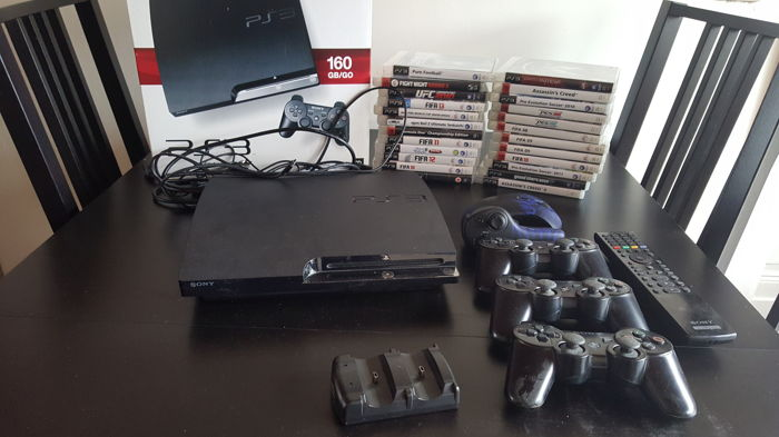 PlayStation 3 (PS3) Slim 160GB, 3 controllers and 24 games