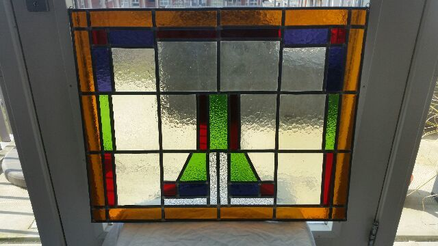 Large stained glass panel in Art Deco style