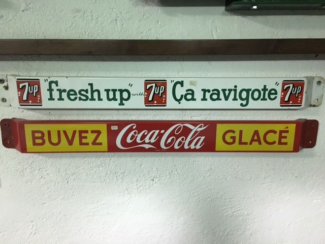 Old Coca Cola and 7 Up advertising signs in enamelled iron 1960s.