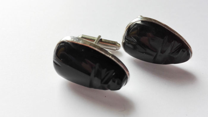 Pair of antique cufflinks with mask, 800 silver with carved onyx