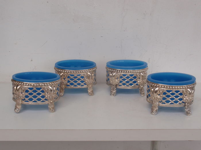 A set of four open work silver salt- and herb cellars with blue opalescent glass, The Netherlands, 19th century
