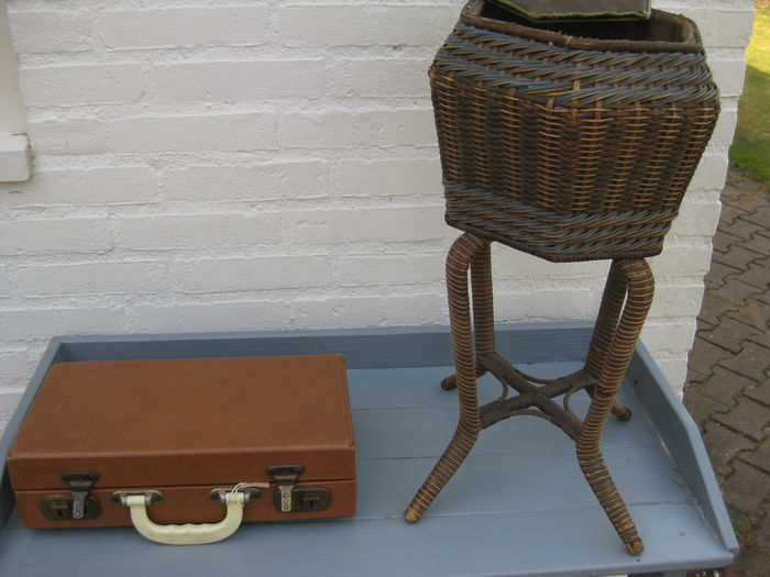 A beautiful wicker sewing basket and an old briefcase