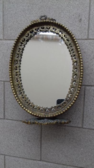 Antique oval bathroom mirror, with base, in gilded bronze -