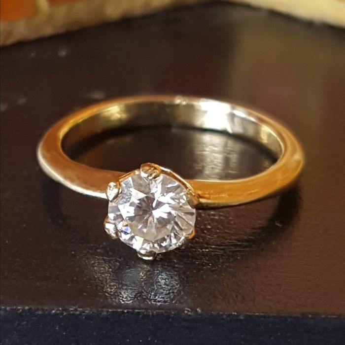 Handmade engagement ring with heat-tested white sapphire