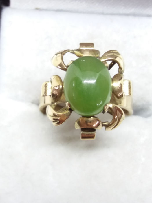 Spinach green Jade held in heavy 14k gold ring. No Reserve.
