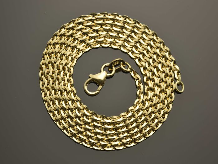 "18k Gold. Solid Chain ""Oval, diamond cut"" · Length 60 cm · Weight 9.23 g."