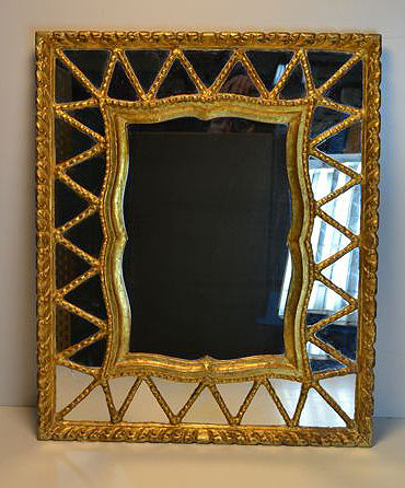 A gilded wooden Spanish mirror, mid 20th century